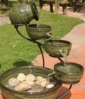 exterior-decoration-divine-outdoor-water-fountains-design-with-green-jars-model-and-natural-stone-extraordinary-outdoor-water-fountains-designs-will-suitable-for-backyard-and-front-garden